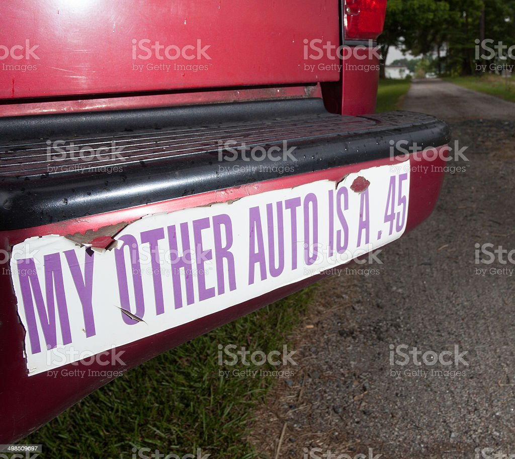 Gun bumper sticker stock photo