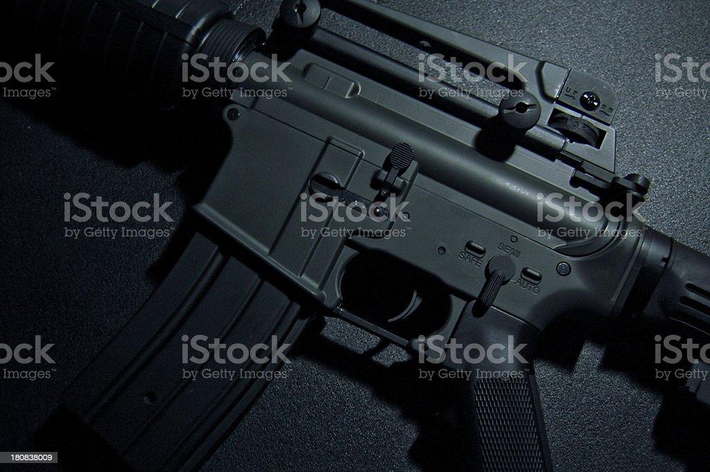 Gun close up over grunge background stock photo
