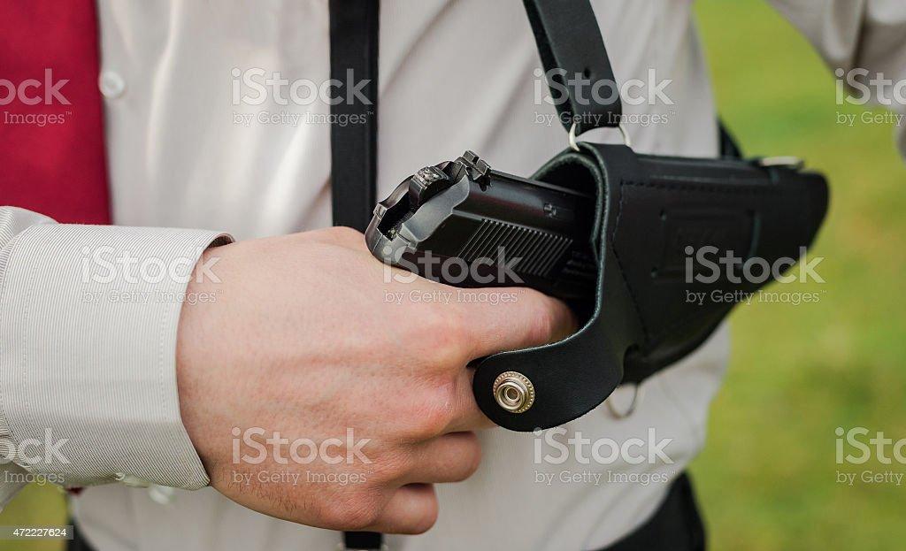 gun from holster stock photo
