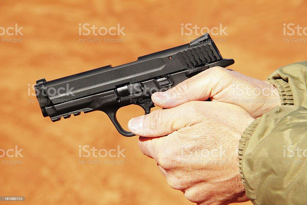 Gun Holding Hands Man Handgun stock photo