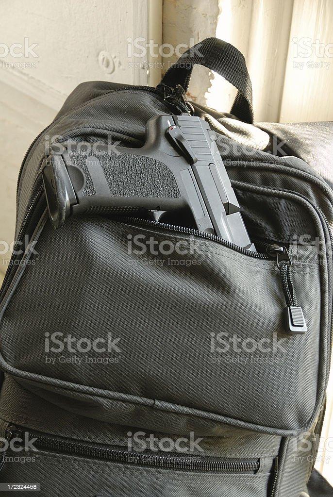 Gun in Bookbag royalty-free stock photo
