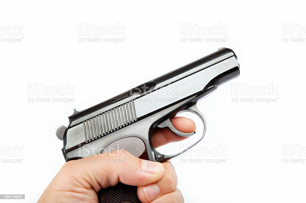 Gun in hand on a white background. stock photo