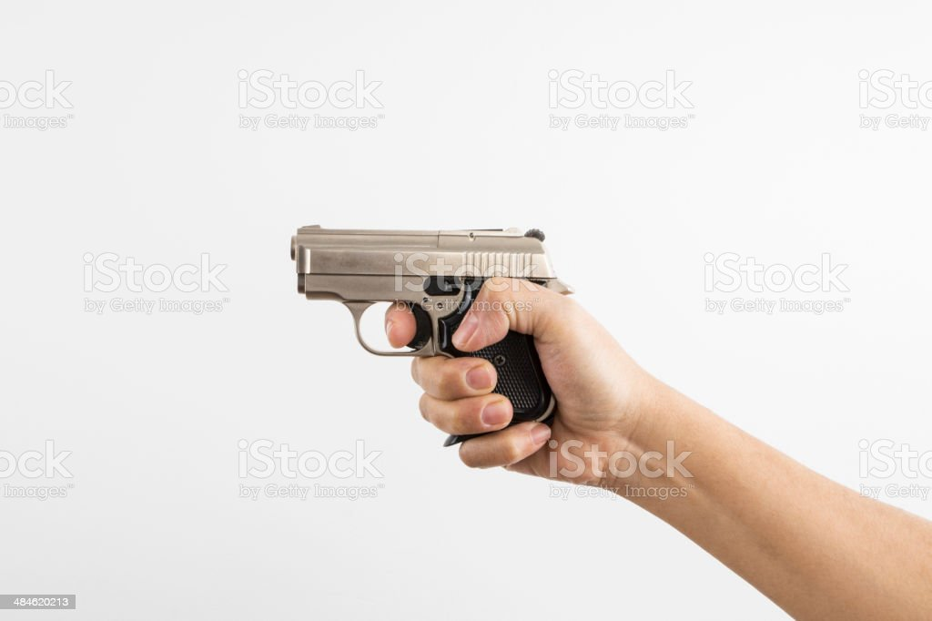 Gun in Hand stock photo