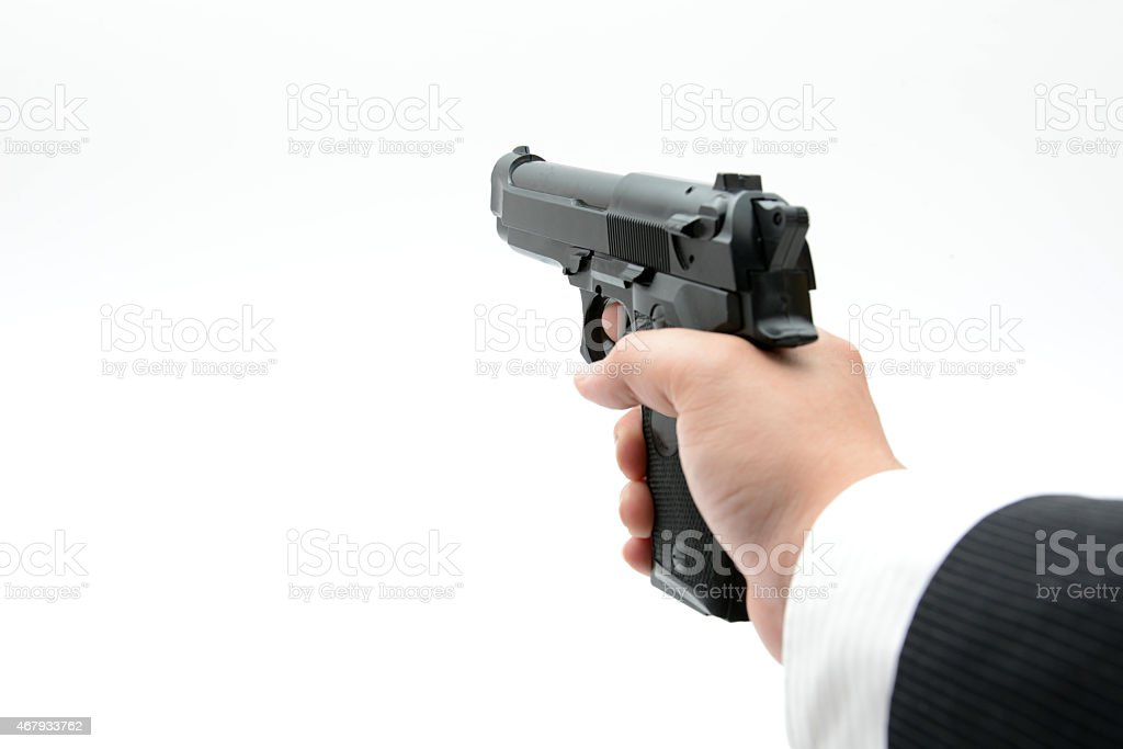 Gun in male hand stock photo