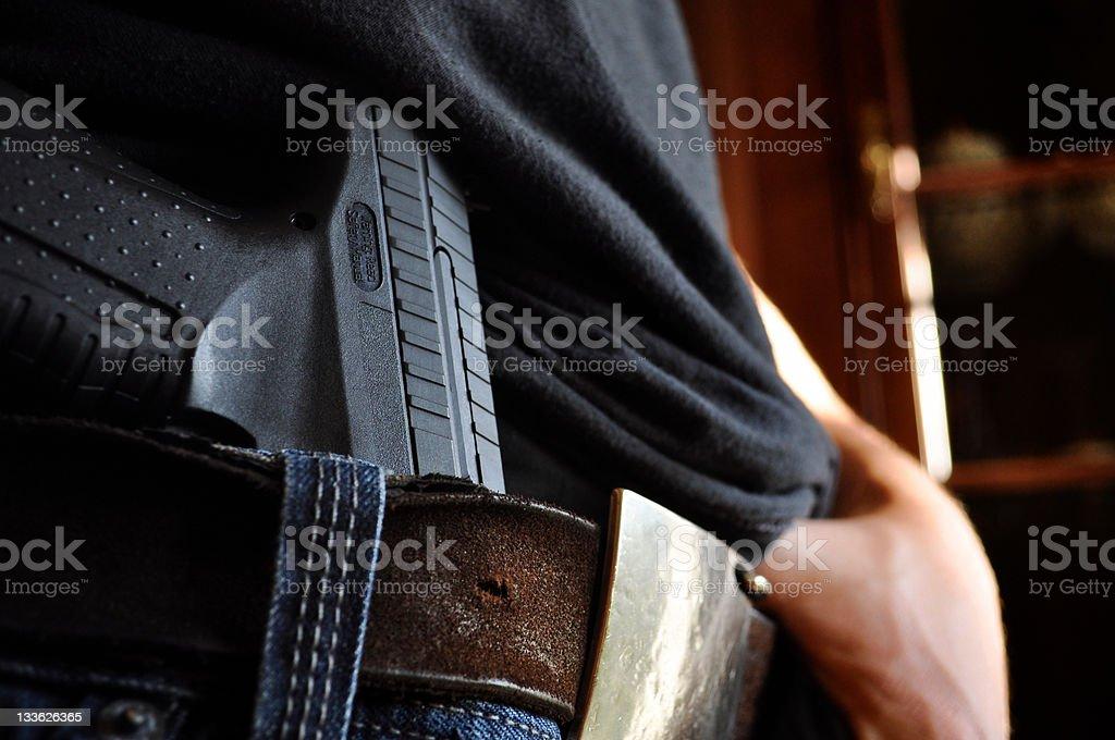 Gun in Pants stock photo