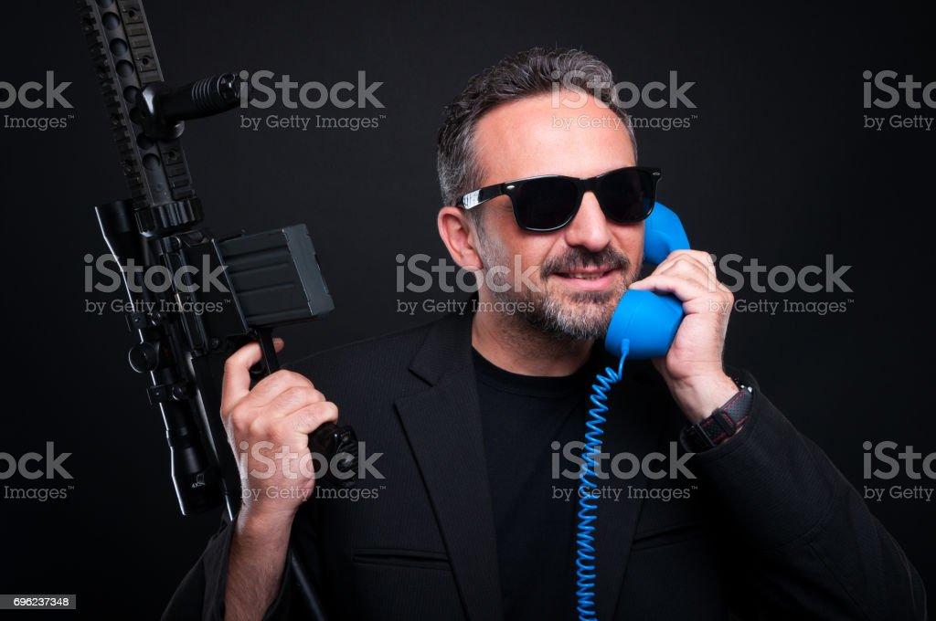 Gun man dealer talking on phone stock photo