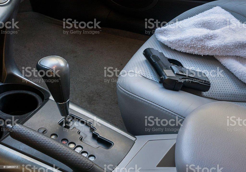gun on car seat stock photo