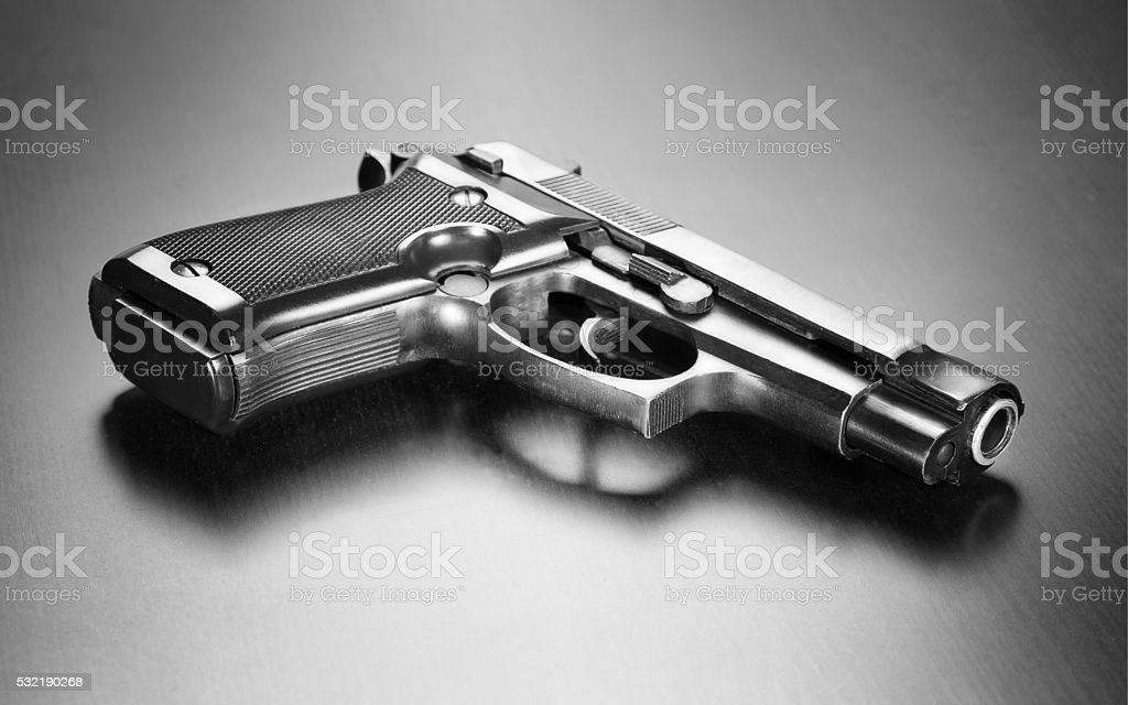 Gun on desk stock photo