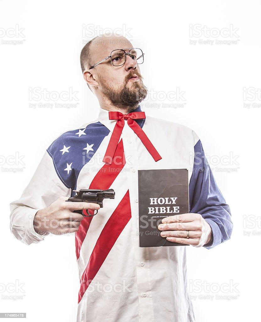 Gun Pointing at Holy Bible royalty-free stock photo