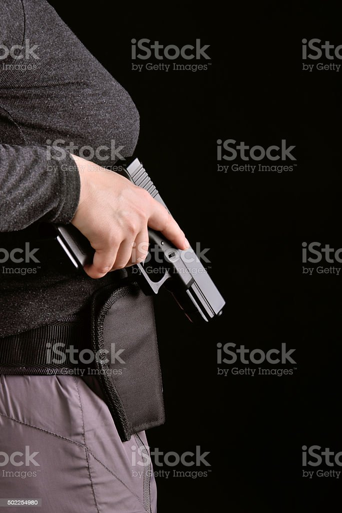 Gun pulled from holster stock photo