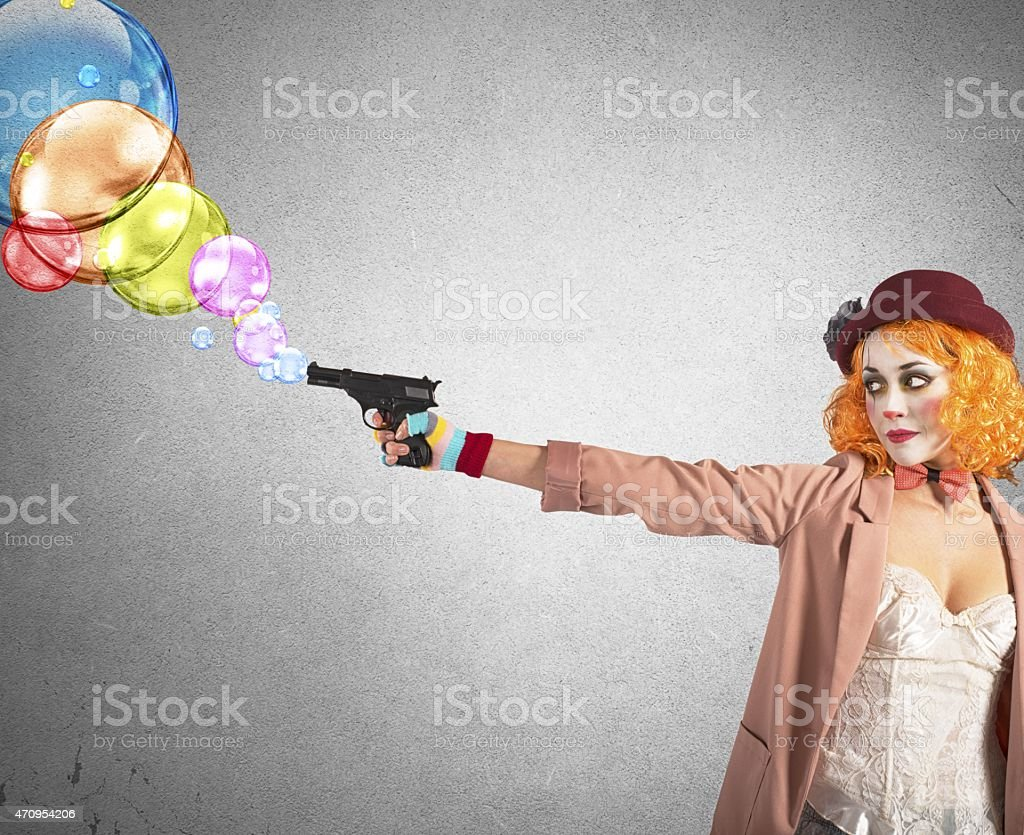 Gun shoots bubbles stock photo