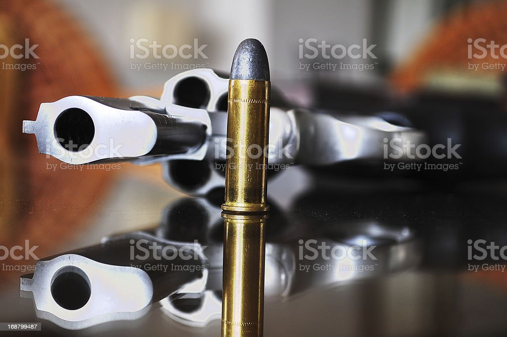 Gun with bullet. royalty-free stock photo