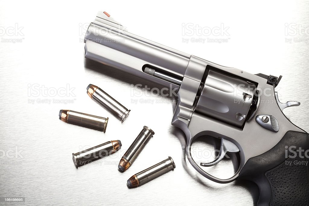 gun with bullets on steel stock photo