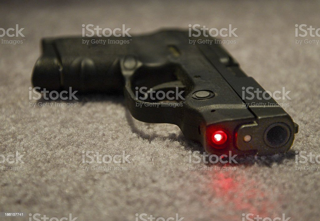 Gun with Laser Sight royalty-free stock photo