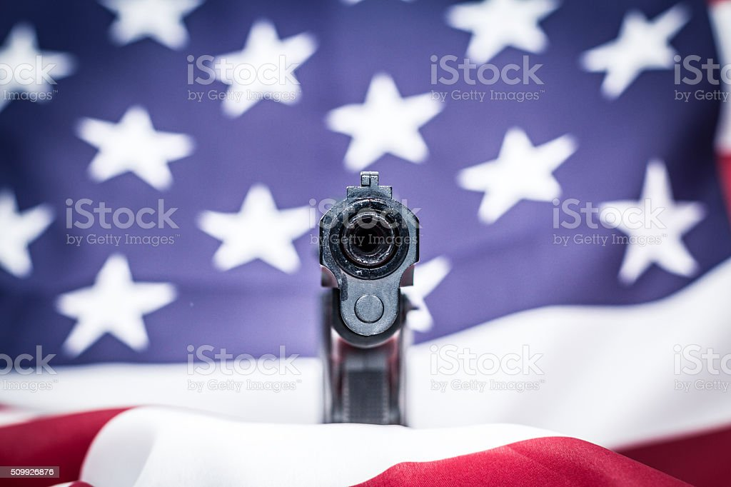 Gun with USA flag stock photo