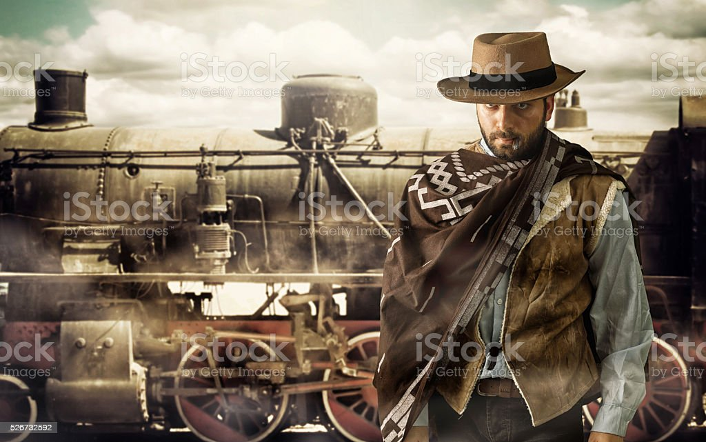 Gunfighter at the train station. stock photo