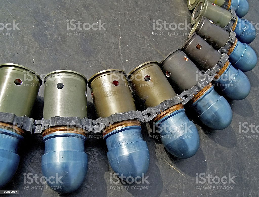 Gun-launched grenades in a bandolier stock photo