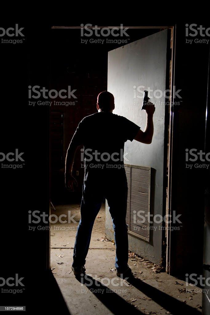 Gunman in Doorway stock photo
