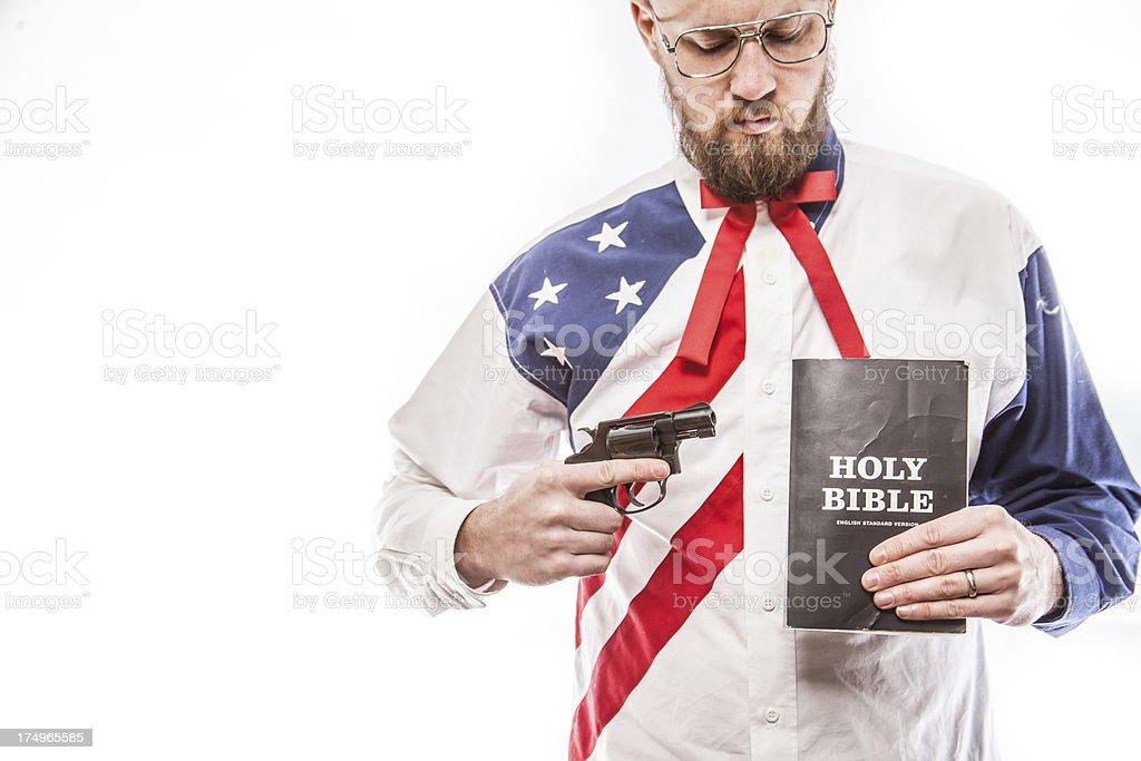 Guns and the Holy Bible royalty-free stock photo