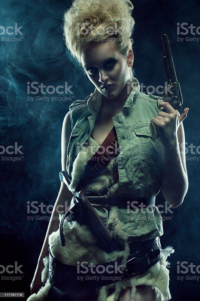 Gunslinger at Night With Pistol stock photo