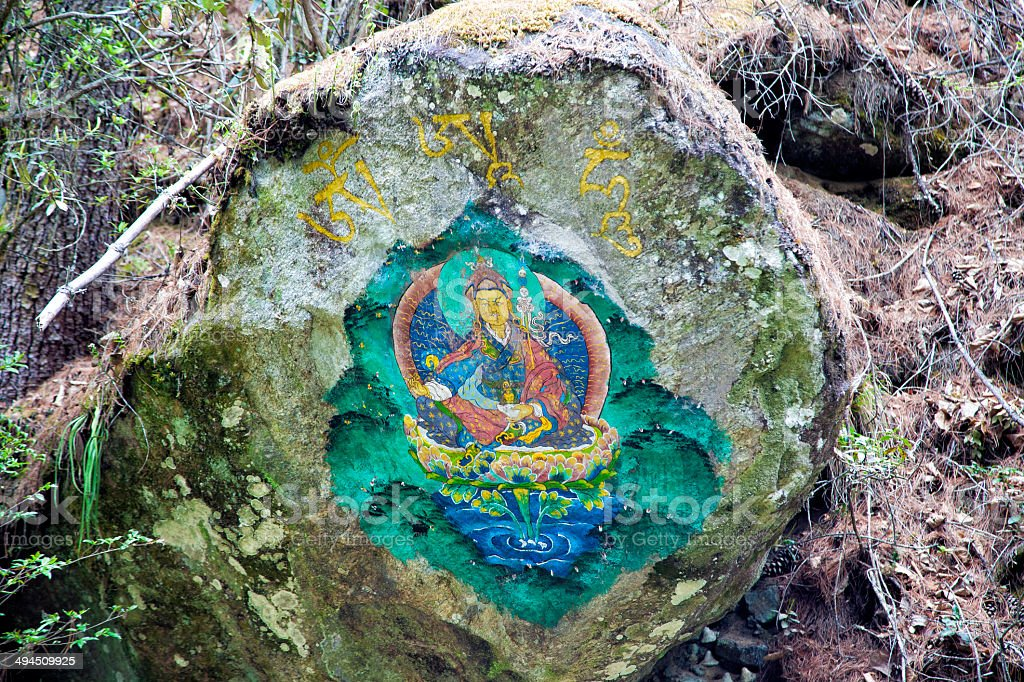 Guru Rinpoche on rock at Tiger's Nest stock photo