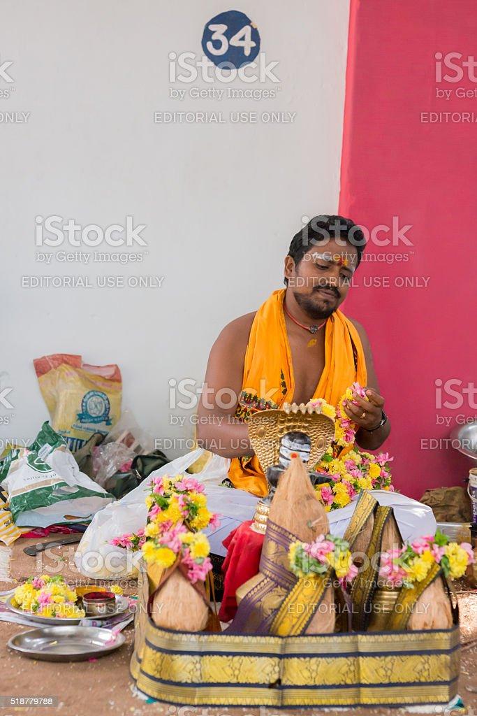 Guru waits for customers at Amma Mandapam. stock photo