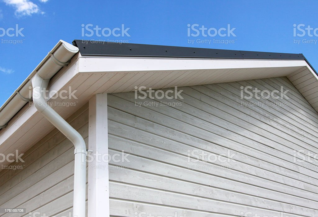 Gutters and drains on a wooden house stock photo