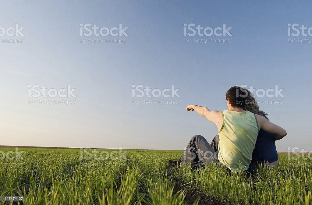 guy and girl in the field royalty-free stock photo