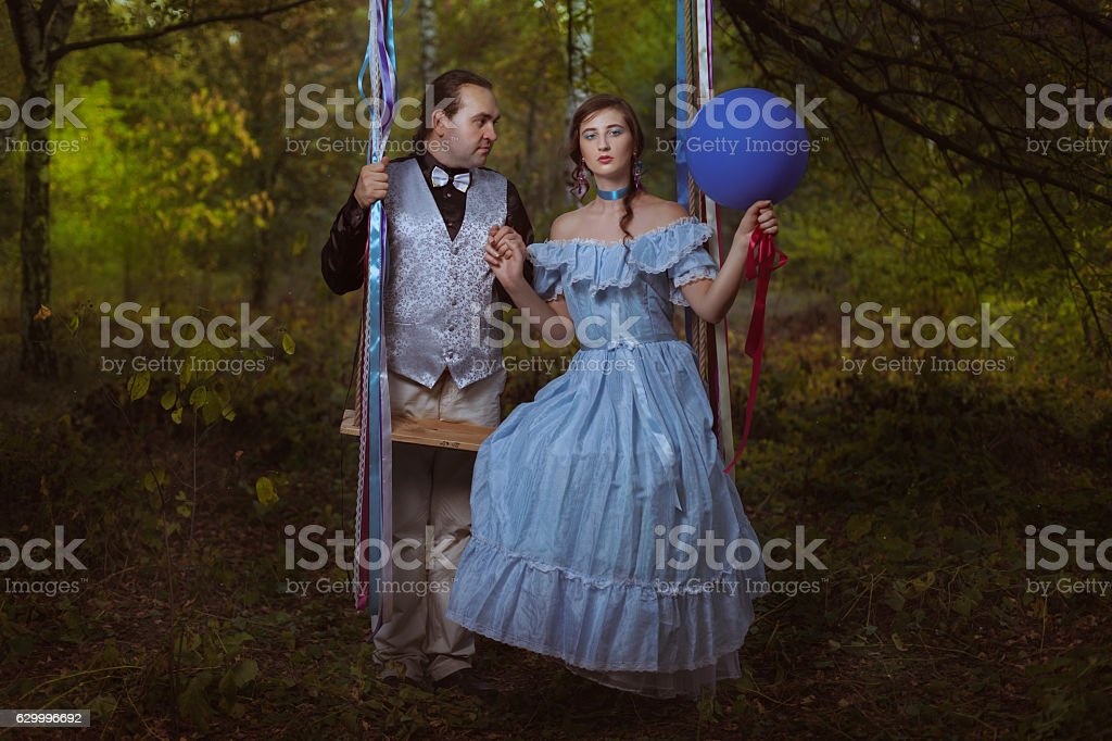 Guy and girl in the forest. stock photo