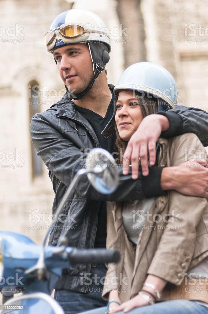 Guy and Girs Hugging on a Motor Scooter royalty-free stock photo