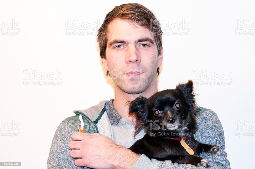 Guy and his chihuahua stock photo