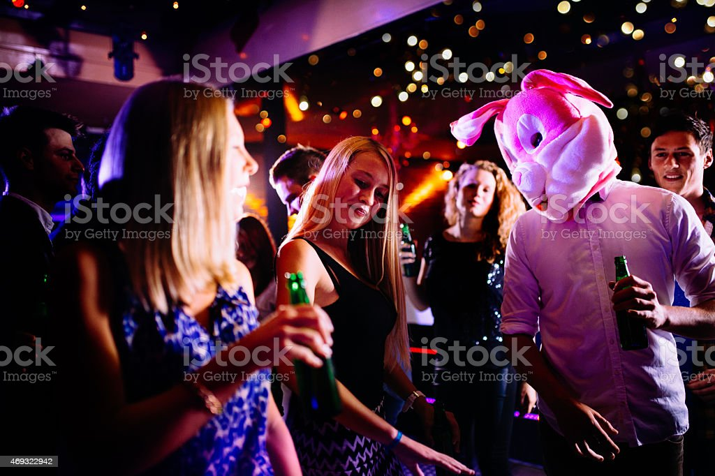 Guy as bunny at party club next young woman dancing stock photo