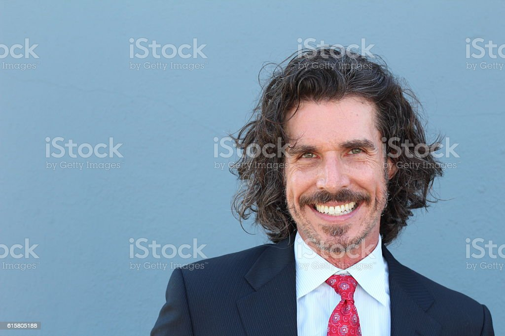 Guy at the office with a huge smile stock photo