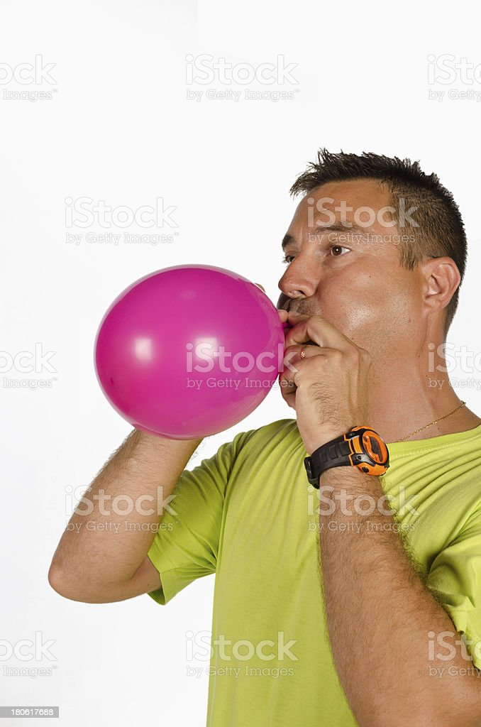 Guy blowing up a balloon stock photo