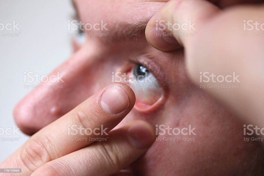 guy bringing in a contact lense royalty-free stock photo