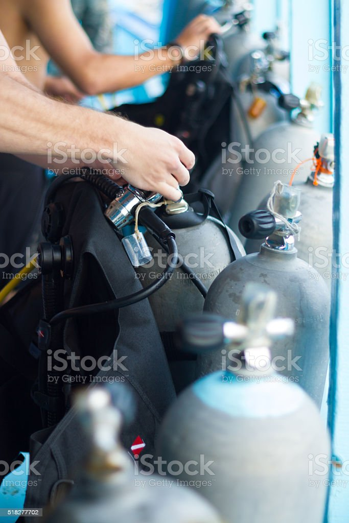 Guy checking the diving equipment. stock photo
