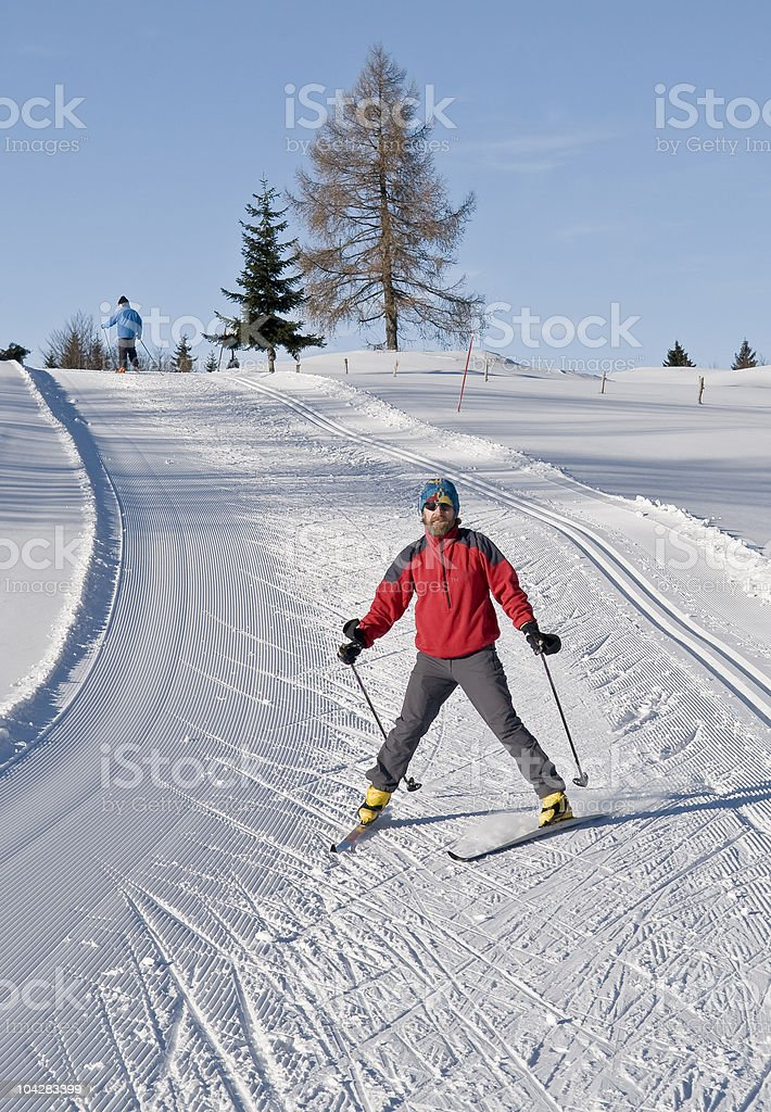 A guy enjoying Cross country skiing at beginner hill! royalty-free stock photo