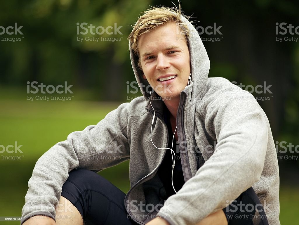 Guy Enjoying His MP3 at the Park royalty-free stock photo