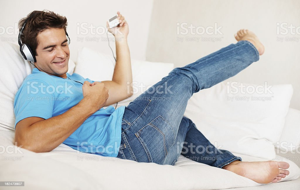 Guy enjoying music while playing air guitar royalty-free stock photo