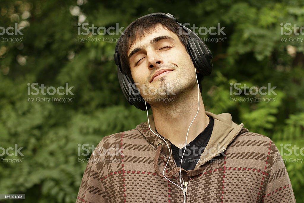 Guy enjoys music royalty-free stock photo