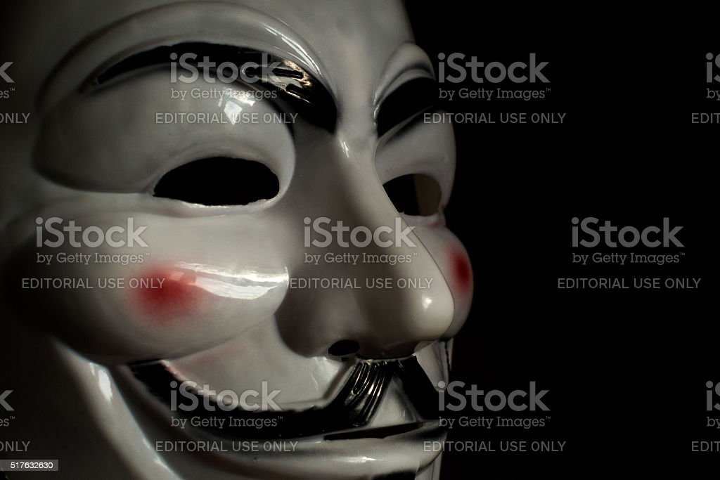 Guy Fawkes Mask on a Wooden Background stock photo