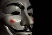Guy Fawkes Mask on a Wooden Background