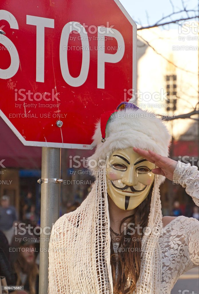 Guy Fawkes Mask, Stop Sign and Salute stock photo