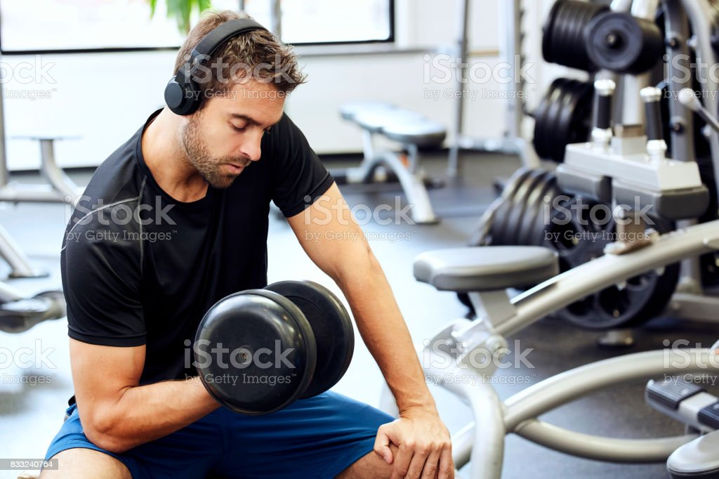 Guy hitting weights stock photo