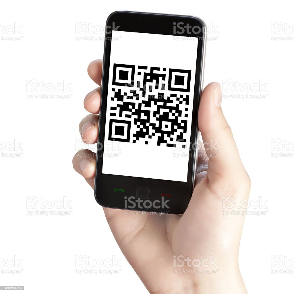 A guy holding a phone with the screen showing the QR code stock photo