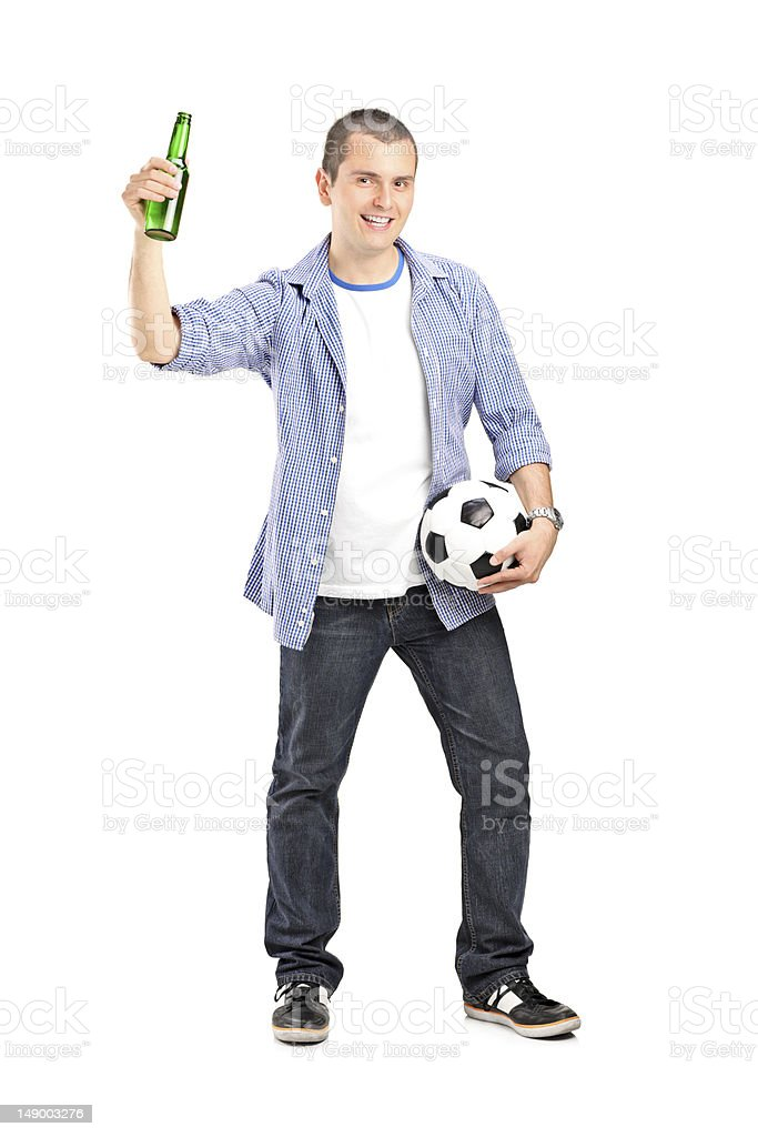 Guy holding football and beer royalty-free stock photo