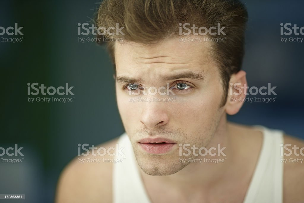 guy in bathroom looking into the mirror after a shower royalty-free stock photo
