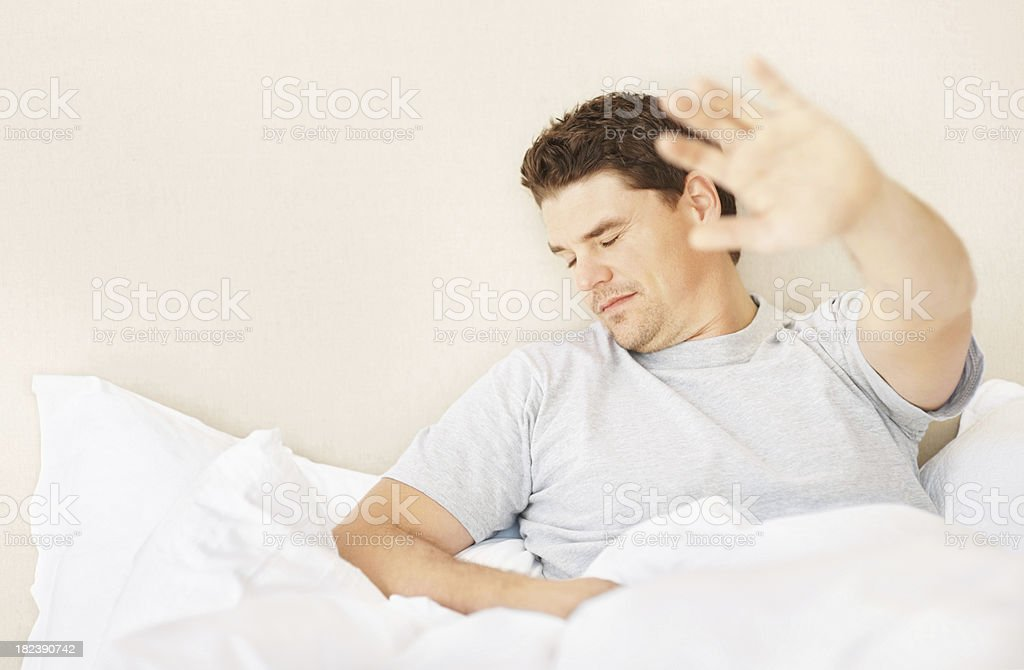 Guy in bed showing stop sign royalty-free stock photo