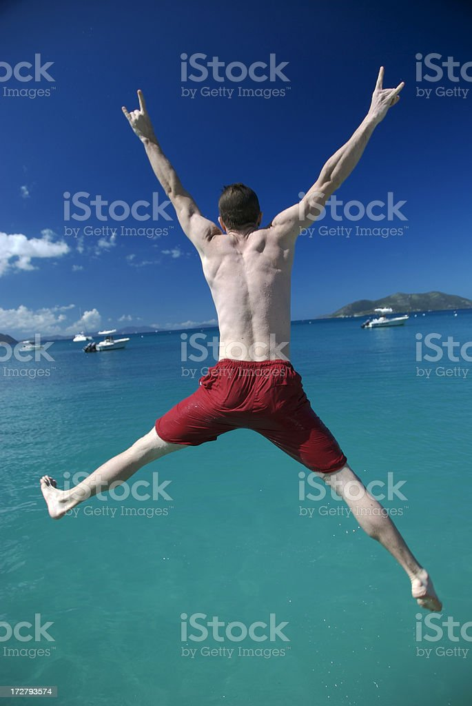 Guy in Red Shorts Leaps into the Sea royalty-free stock photo