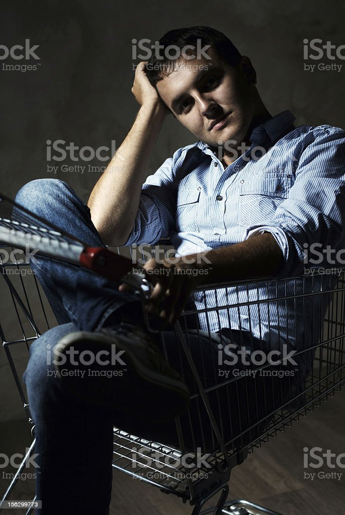 guy in shopping cart royalty-free stock photo